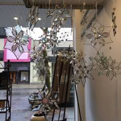 Glass snowflakes for sale at Forty-Five North Art Gallery.