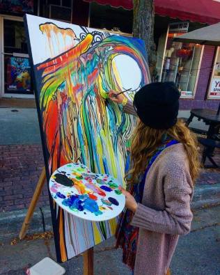 Artist Anneliese Mathia paints at last year's event. Photo by Anneliese Mathia.