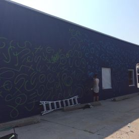 Last year's mural in progress.