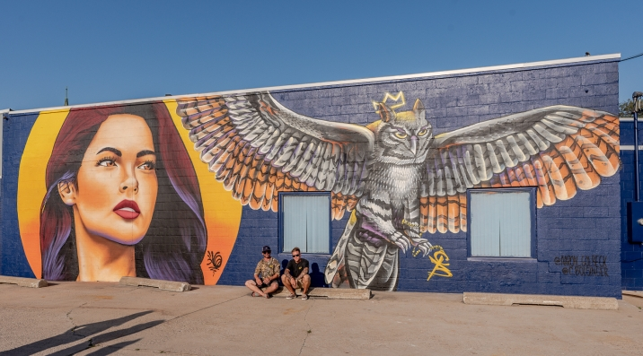 Artists Aaron Golbeck and Chad Bolsinger in front of the completed mural.